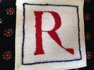 Dad's initial in satin stitch
